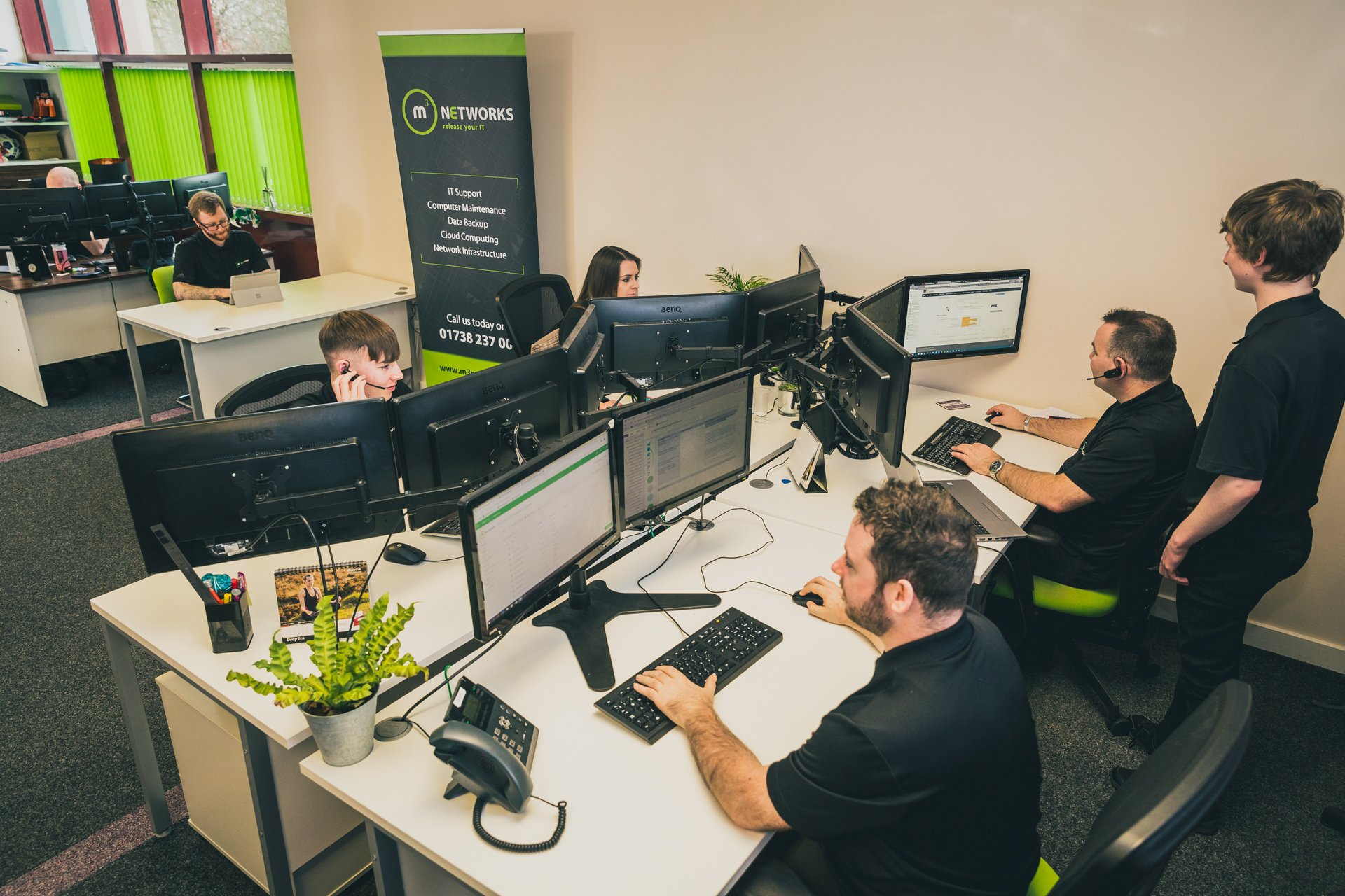 Photo of the m3 Networks team at work in the office